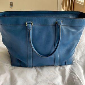 Coach leather overnight bag.